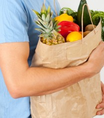 Attractive male bag holding supermarket shopping man